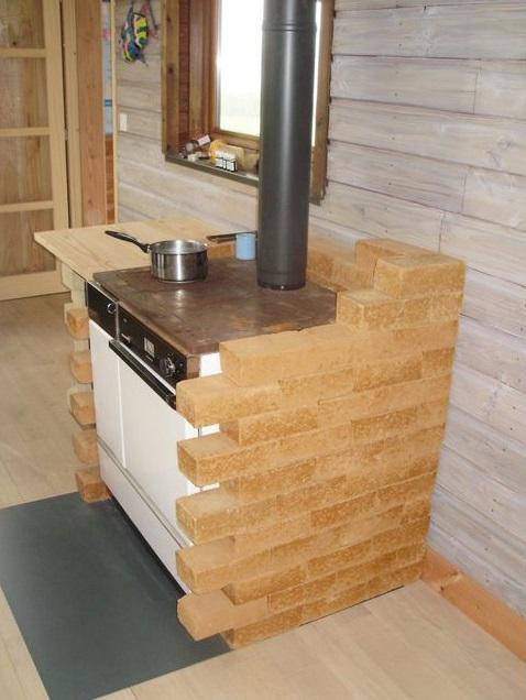 Mur inertie thermique cuisinière à bois