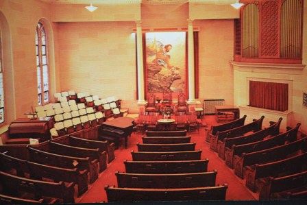 The sanctuary originally included opalescent trompe l'oeil stonework and a large mural. The congregation took the mural with them when they moved to a new location.