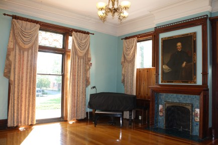 The formal sitting room and portratit of D.D. Bell.