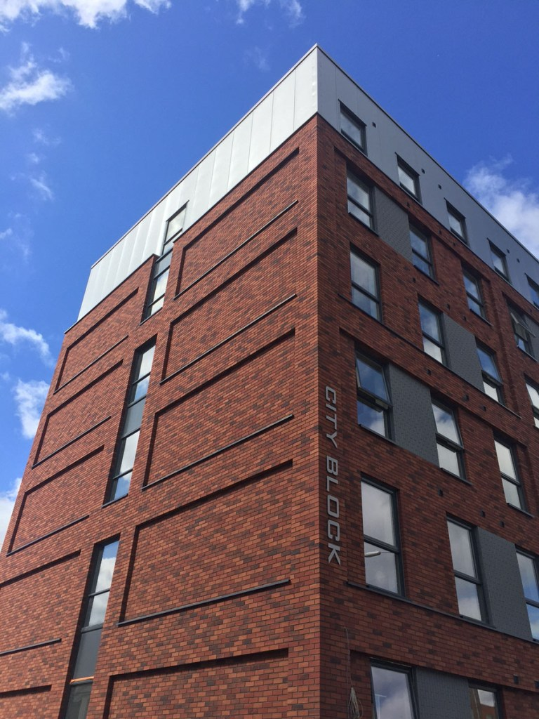 An external wall insulation and brick slip façade combination from Sto has been used to create attractive new elevations for the CityBlock building in Reading.