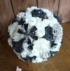 Black roses and brooch bouquet