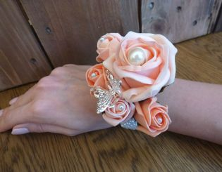 Coral and peach pearl wrist corsage