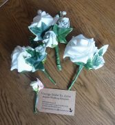 Ivory and ivy buttonholes