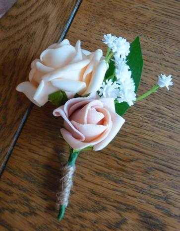 Peach and pink gypsophila buttonhole