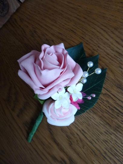 Pink and pearl buttonhole