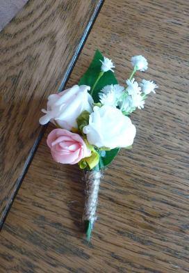 Pink gypsophila baby buttonhole