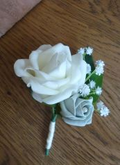 Rose and gypsophila buttonholes