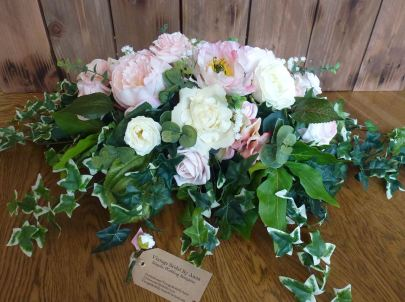 Rose and peony top table arrangement wedding