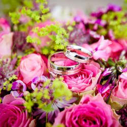 Pink Flowers with wedding rings