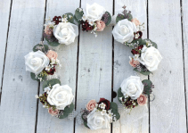 white rose and burgundy wrist corsages
