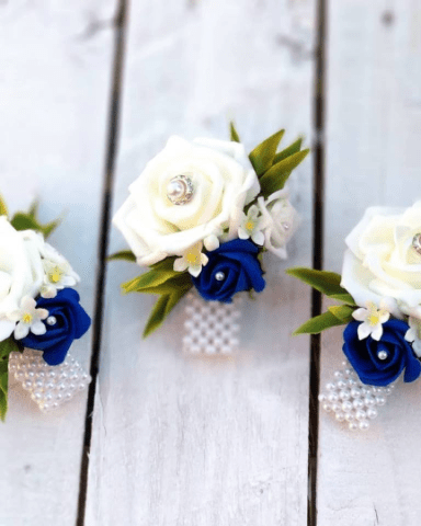white rose and royal blue wrist corsage