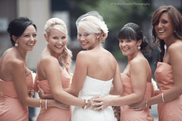 peach bridesmaid's dresses and bride with birdcage veil   esther louise photography