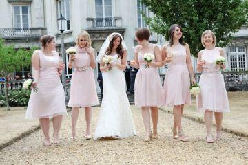 bride walking with pale blush pink mismatched bridesmaids