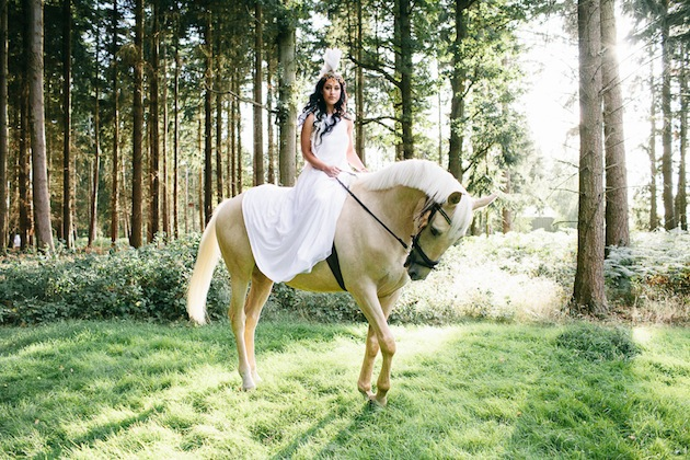 Unique Wedding Inspiration Featuring A Bride in A Feathered Headdress & A Horse