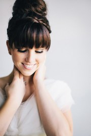brides with bangs; wedding hair