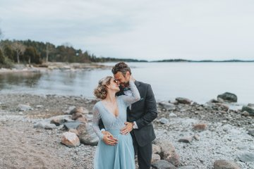Stormy Scandinavian Wedding Inspiration Featuring a Dramatic Blue Gown | Snowflake Photo 12