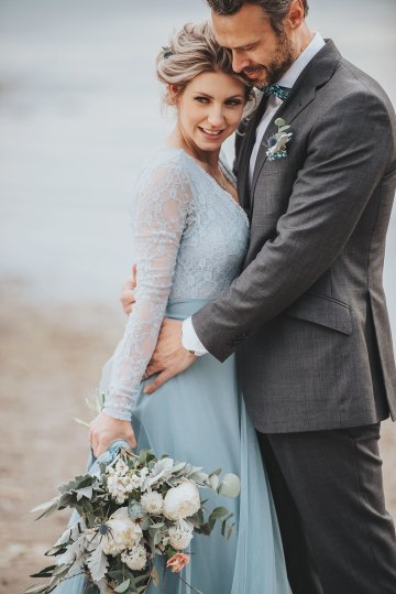 Stormy Scandinavian Wedding Inspiration Featuring a Dramatic Blue Gown | Snowflake Photo 26