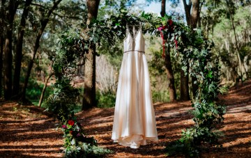 Woodsy Jewel-Toned Wedding Ideas With A Trendy Circle Arch