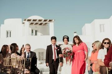 Intimate & Luxurious Cliffside Santorini Wedding   Stella and Moscha   Nikos Gogas 39