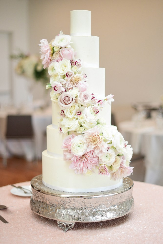 Tall Tiered White Wedding Cake with Cascading Florals