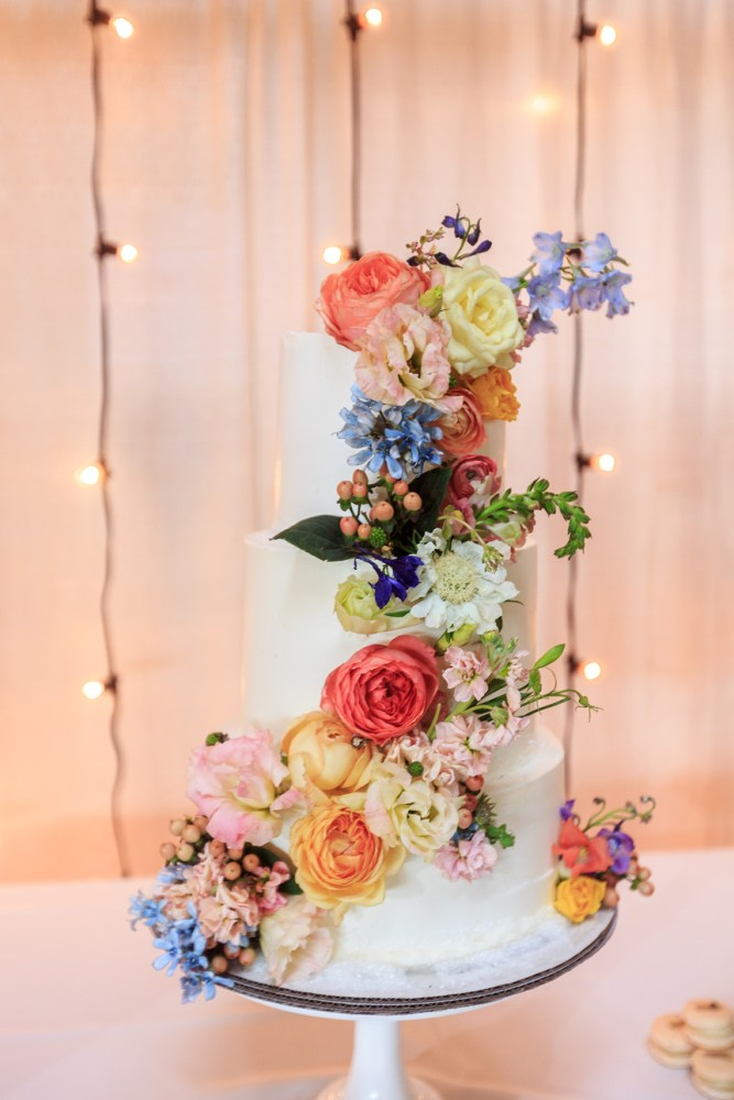 Tall Tiered Wedding Cake with Rainbow Florals