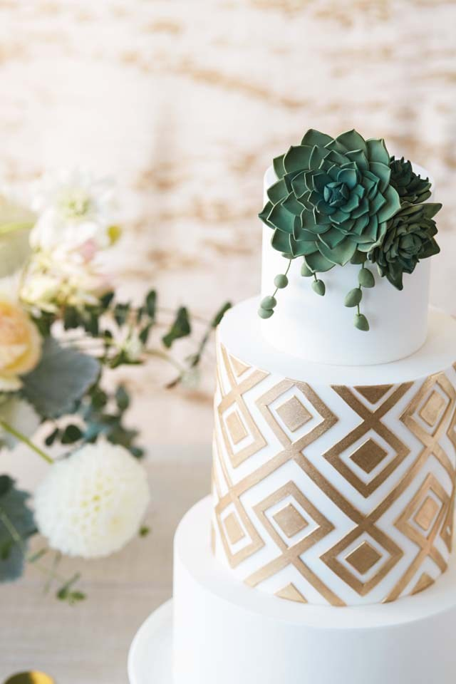 White & Gold Geometric Wedding Cake with Succulents