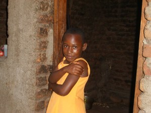Happy girl standing in a doorway.