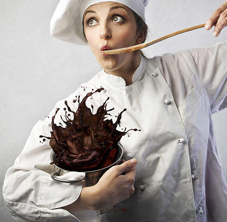 chef with splashing chocolate in a pan