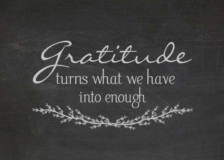 gratitude quote on dusty black chalkboard