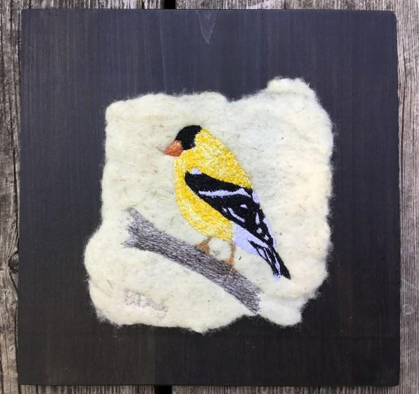 thread painted goldfinch on felt