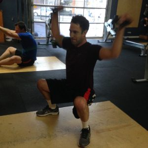 Bridgetown CrossFit Strength and Conditioning client performing Should Mobility exercise Squat + Face Pull