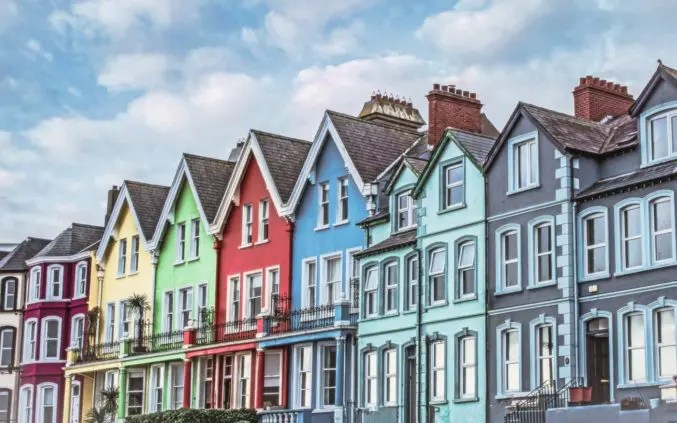 A rows of brightly coloured terrace houses in the UK
