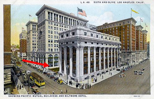 The red arrow points to the historic courtyard that existed before a one-story building was built there after WWII