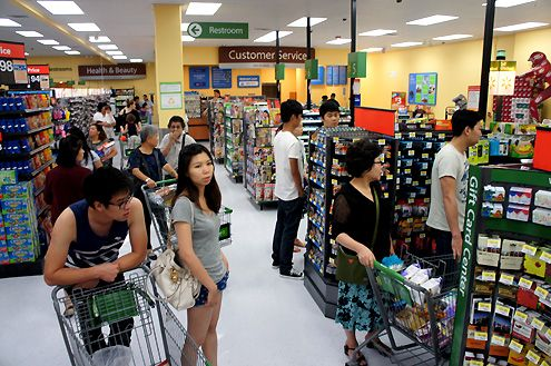 Customers waiting to purchase at the new Walmart Neighborhood Market in Chinatown