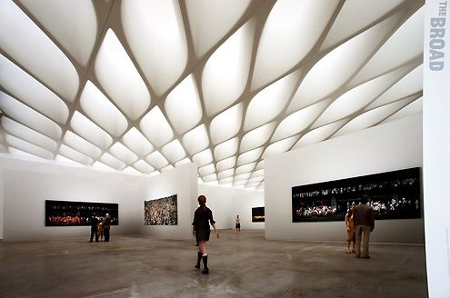 Exhibition space illuminated by natural light above