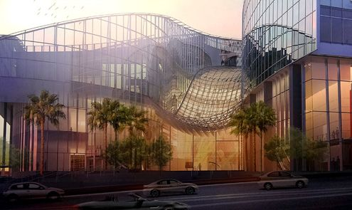 A view of the ground level at the corner of 7th and Figueroa with its undulating glass facade