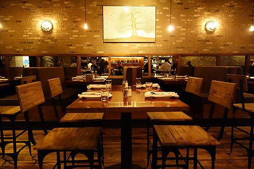 Warm wood panels and distressed brick give City Tavern a modern rustic ambiance
