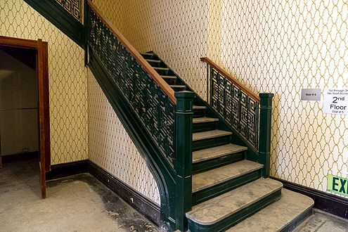 Refurbished staircase on the second floor with new wallpaper