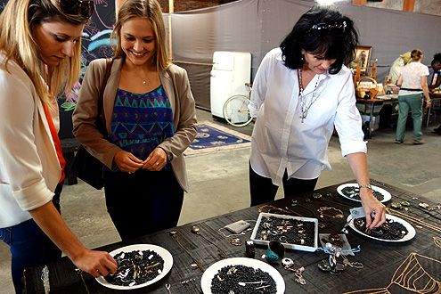 Arts District Flea shoppers look through handmade jewelry by The Last Foundry