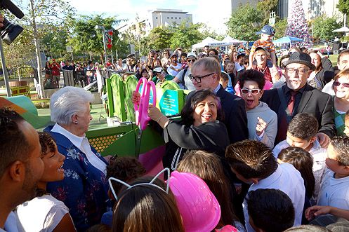 County Supervisor Gloria Molina, who championed the new playground, cuts the ribbon on the grand opening this past Saturday, Nov 22