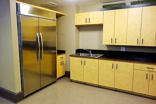 A common area kitchen for residents with modern stainless steel appliances can be used for community gathering events