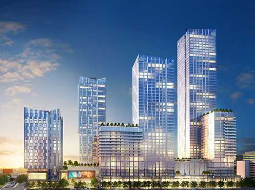 Newest Metropolis renderings released showing four gleaming glass and metal towers abutting the 110 freeway (Photo: Greenland USA)