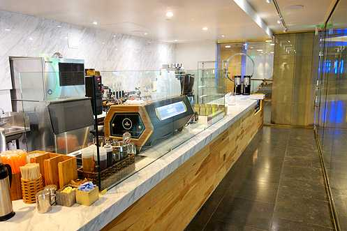 A 30-foot long marble and wood coffee bar
