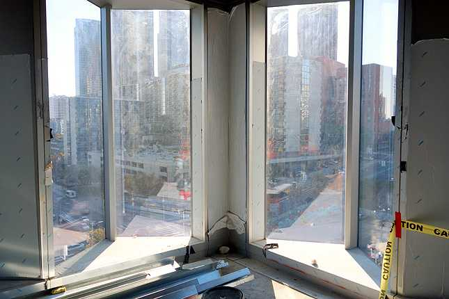 Finally, a look out the window of the DTLA skyline where the zigzag glass panels meet at the corner of the building