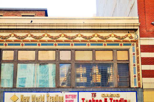 Some ornate historic detailing is left intact on the building's facade