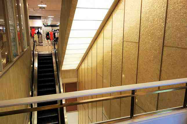 "I am very glad the original golden speckled panels from its ""Broadway department store days"" (before Macy's bought out Broadway) still remains by escalators"