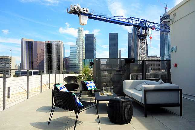 The rooftop lounge deck offers spectacular views of the DTLA skyline
