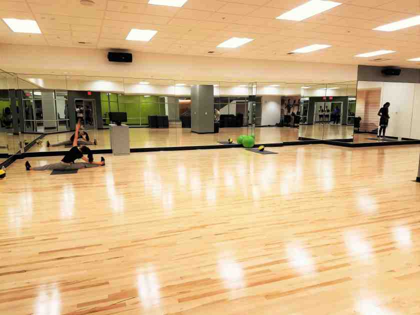 A large workout studio for group fitness is located on the basement level