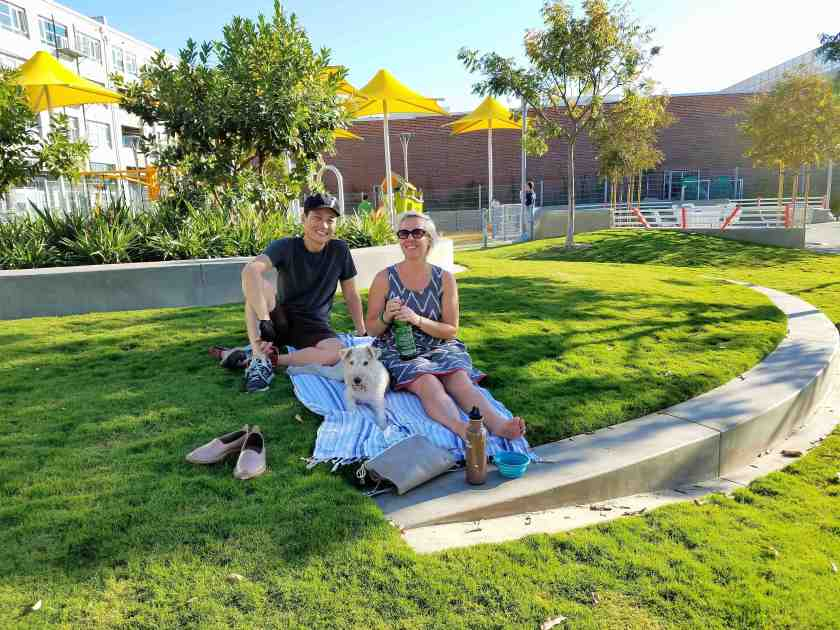 Arts District residents since 2006, Andy and Porsha with their dog Berkeley, think added green space makes the community more livable and enjoyable