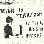 """War is Terrorism with a bigger budget"" graffitied on a wall"